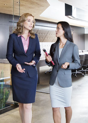 Two women discussing Right Management's outplacement services in an office.